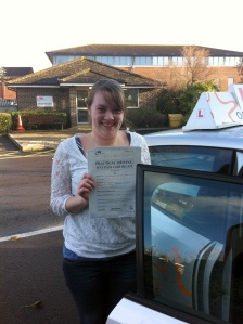 Jacqueline with her Practical Driving Test Pass Certificate outside Weston Super Mare Driving Test Centre
