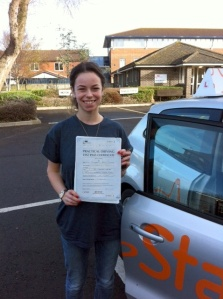Lizzie with her Driving Test Pass Certificate outside Weston-super-Mare Driving Test Centre