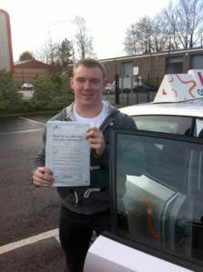 Dan with his Practical Driving Test Pass Certificate outside Weston-super-Mare Driving Test Centre