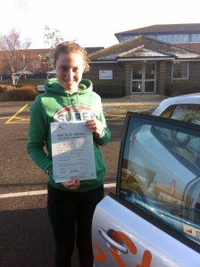 Beth with her Practical Driving Test Pass Certificate outside Weston-super-mare Driving Test Centre