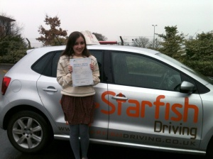 Emily with her Practical Driving Test Pass Certificate outside Weston super Mare Driving Test Centre