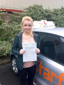 Bessie with her Practical Driving Test Pass Certificate outside Weston-Super-Mare Driving Test Centre
