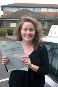 Caitlin with her Practical Driving Test Pass Certificate outside Weston-super-Mare Driving Test Centre.