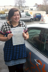 Emma with her Practical Driving Test Pass Certificate somewhere in Weston-super-Mare.