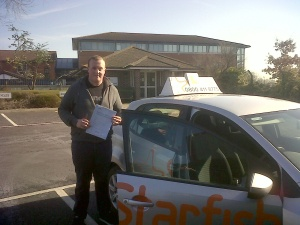 James with his Practical Driving Test Pass Certificate outside Weston-super-Mare Driving Test Centre