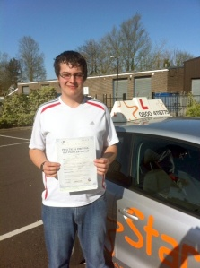 Craig with his Practical Driving Test Pass Certificate outside Weston-super-Mare Driving Test Centre