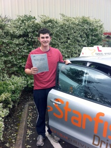 Jack with his Practical Driving Test Pass Certificate outside Weston-Super-Mare Driving Test Centre.