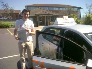 Billy with his Practical Driving Test Pass Certificate outside Weston-Super-Mare Driving Test Centre