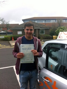 Ryan with his Practical Driving Test Pass Certificate outside Weston-Super-Mare Driving Test Centre