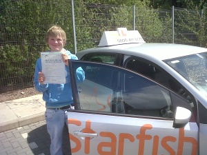 Will Bell with his Practical Driving Test Pass Certificate outside Taunton Driving Test Centre