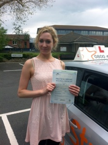Ruby with her Practical Driving Test Pass Certificate outside Weston-Super-Mare Driving Test Centre.
