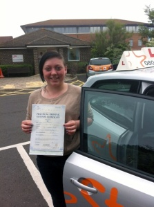 Emma with her Practical Driving Test Pass Certificate outside Weston-super-Mare Driving Test Centre