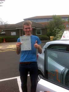 Joel with his Practical Driving Test Pass Certificate outside Weston-super-Mare Driving Test Centre
