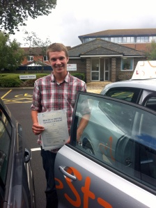 Dan with his Practical Driving Test Pass Certificate outside Weston-super-Mare Driving Test Centre.