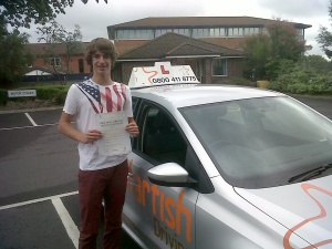 Tom with his Driving Test Pass Certificate outside Weston-super-Mare Driving Test Centre