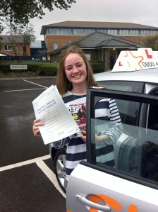 Amy with her Practical Driving Test Pass Certificate outside Weston-super-Mare Driving Test Centre.