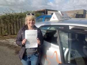 Felicity with her Practical Driving Test Certificate near Weston-super-Mare Driving Test Centre.