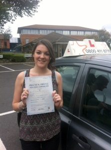 Izzi with her Practical Driving Test Pass Certificate outside Weston-super-Mare Driving Test Centre.
