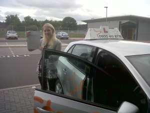 Kirsty with her Practical Driving Test Pass Certificate outside Taunton Driving Test Centre