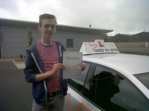 Luke with his Practical Driving Test Pass Certificate outside the Driving Test Centre in Taunton