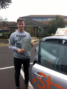 Adam with his Driving Test Pass Certificate outside Weston-Super-Mare Driving Test Centre