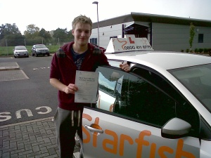 Allie with his Driving Test Pass Certificate outside Taunton Driving Test Centre
