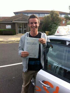 Joe with his Practical Driving Test Pass Certificate outside Weston-Super-Mare Driving Test Centre.