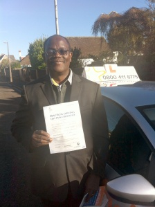 Issac with his Practical Driving Test Pass Certificate somewhere in Weston-Super-Mare