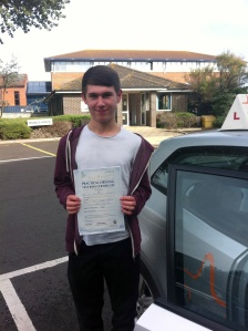 Jake with his Practical Driving Test Pass Certificate outside Weston-Super-Mare Driving Test Centre