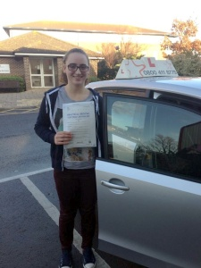 Ashley with her Practical Driving Test Pass Certificate outside Weston-Super-Mare Driving Test Centre