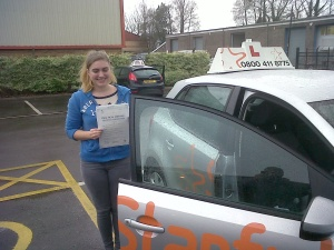 Harley with her Practical Driving Test Pass Certificate outside Weston-super-Mare Driving Test Centre