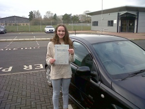 Lottie with her Driving Test Pass Certificate outside Taunton Driving Test Centre.