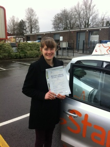 Charlotte with her Driving Test Pass Certificate outside Weston-super-Mare Driving Test Centre