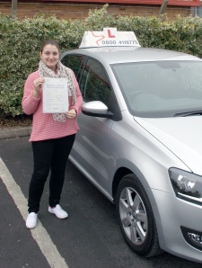 Susan with her Practical Driving Test Pass Certificate outside Weston-Super-Mare Driving Test Centre