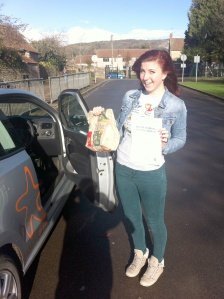 Tabi with her Practical Driving Test Pass Certificate outside McDonalds in Weston-super-Mare