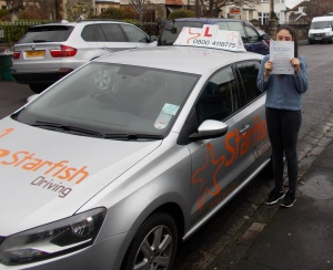 Antonia hiding behind her Driving Test Pass Certificate somewhere in Weston-super-Mare