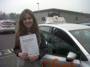 Becky with her Practical Driving Test Pass Certificate outside Taunton Driving Test Centre