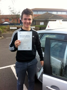 Gabriel with his Driving Test Pass Certificate outside Weston-Super -Mare Driving Test Centre