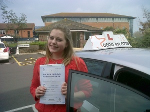 Millie with her Practical Driving Test Pass Certificate outside Weston-super-Mare Driving Test Centre