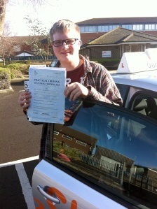 Nathan with his Practical Driving Test Pass Certificate outside Weston-super-Mare Driving Test Centre