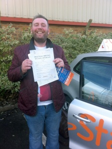 Noel with his Practical Driving Test Pass Certificate outside Weston-super-Mare Driving Test Centre