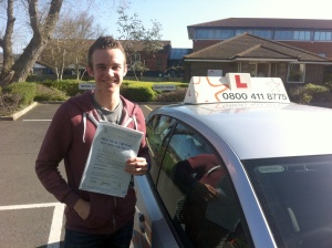 Callum with his Practical Driving Test Pass Certificate outside Weston-super-MAre Driving Test Centre