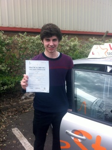 Cam with his Practical Driving Test Pass Certificate outside Weston-Super-Mare Driving Test Centre