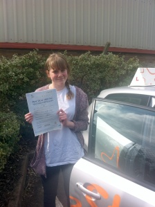 Emily with her Practical Driving Test Pass Certificate outside Weston-super-Mare Driving Test Centre.