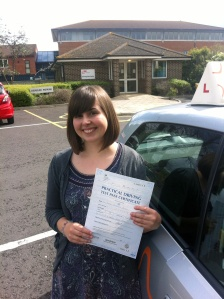 Eleanor with her Practical Driving Test Pass Certificate outside Weston-super-Mare Driving Test Centre.