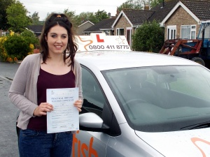 Harriet with her Practical Driving Test Pass Certificate somewhere in Mark.