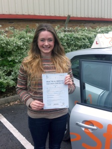 Jade with her Practical Driving Test Pass Certificate outside Weston-super-Mare Driving Test Centre