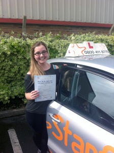Jessica with her Practical Driving Test Pass Certificate outside Weston-super-Mare Driving Test Centre