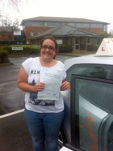 Laura with her Driving Test Pass Certificate outside Weston-super-Mare Driving Test Centre