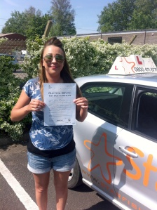 Megan with her Pracitcal Driving Test Pass Certificate outside Weston-Super-Mare Driving Test Centre